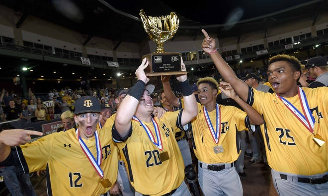 The New Hope Trojans celebrate with the Class 4A trophy after beating Sumrall in game two of the MHSAA Class 4A State Baseball Championship on Friday, May 17, 2019, at Trustmark Park in Pearl.