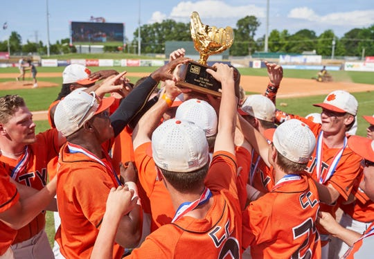 Calhoun City players celebrate with the trophy following the Wilcats 14-4 win over Taylorsville during Game Three of the MHSAA 2A Baseball Championship held at the Trustmark Park in Pearl on Friday, May 18th, 2019.(Bob Smith)