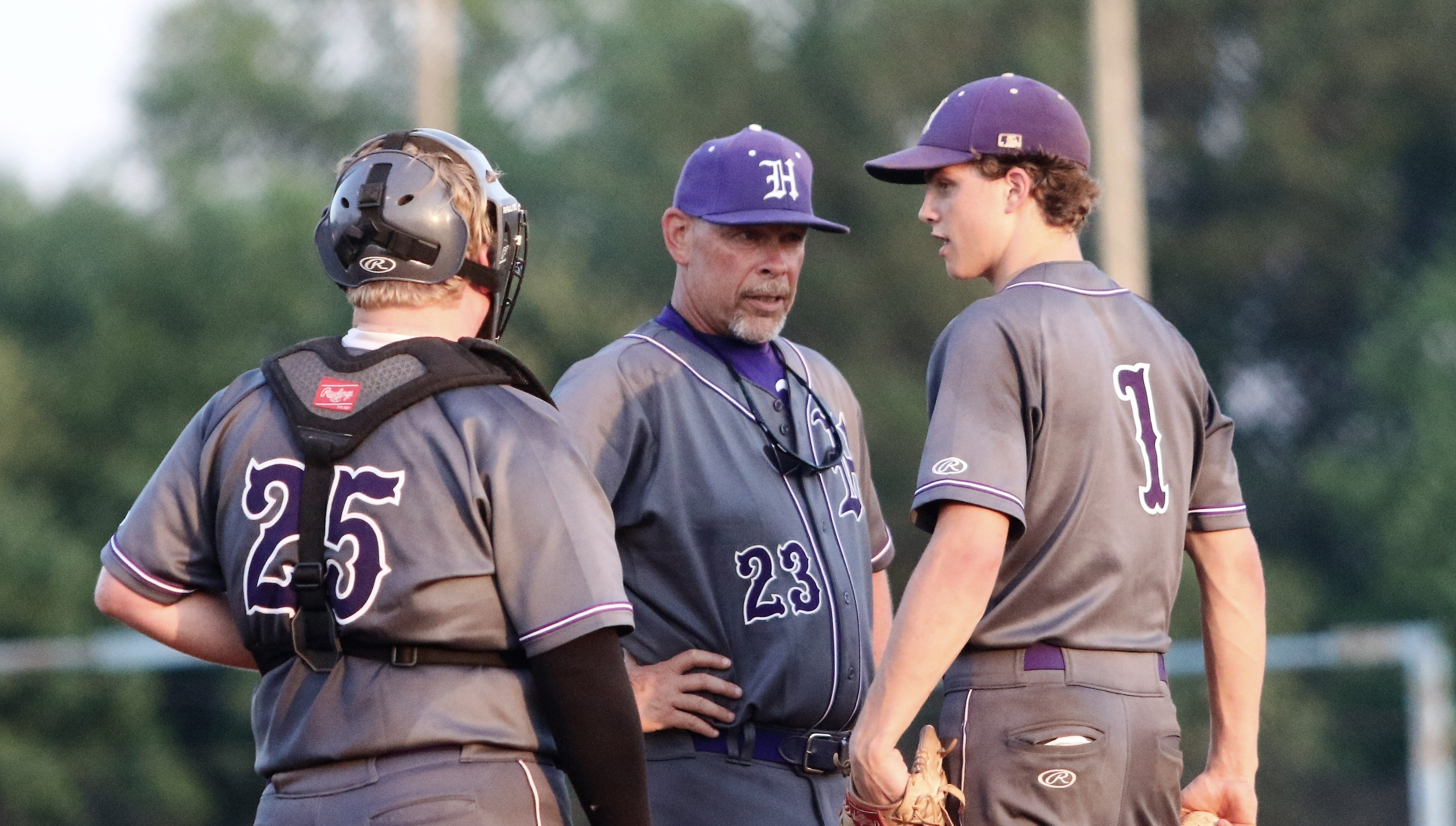 Haywood coach Dusty Rhodes talks to pitcher Andrew Stanley (1) and catcher J.T. Lea against Chester County in a Class AA sectional on May 17, 2019.