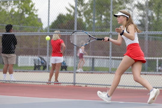 West Lafayette's Emilka Kaluta returns the ball during the IHSAA girls tennis team sectionals, Friday, May 17, 2019, at Cumberland Elementary School in West Lafayette.