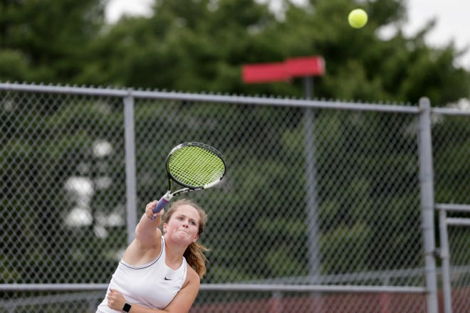 McCutcheon's Amanda Pendleton returns the ball during the IHSAA girls tennis team sectionals, Friday, May 17, 2019, at Cumberland Elementary School in West Lafayette.