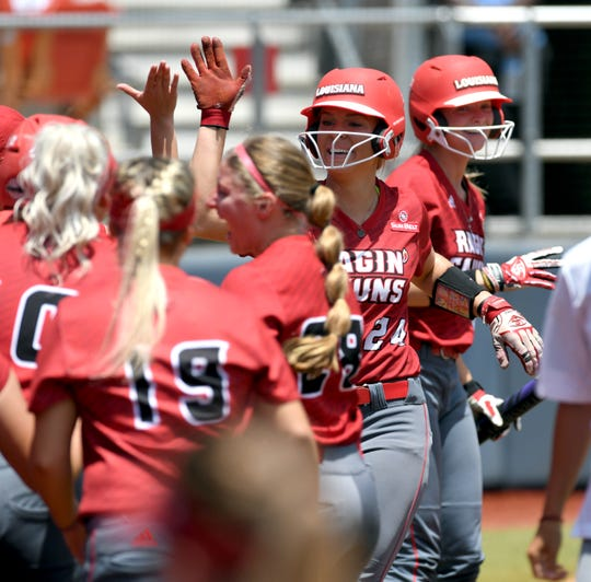 Second baseman Casidy Chaumont is greeted after scoring in UL's 2-0 win over Ole Miss on Saturday. The Rebels beat the Cajuns twice Sunday, though, to knock UL out of the NCAA Tournament.
