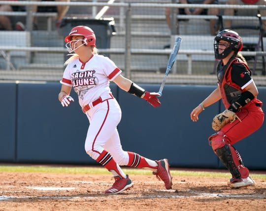UL's Lexie Comeaux delivers the winning hit in Friday's 3-2 NCAA Tournament win in Oxford, Mississippi.
