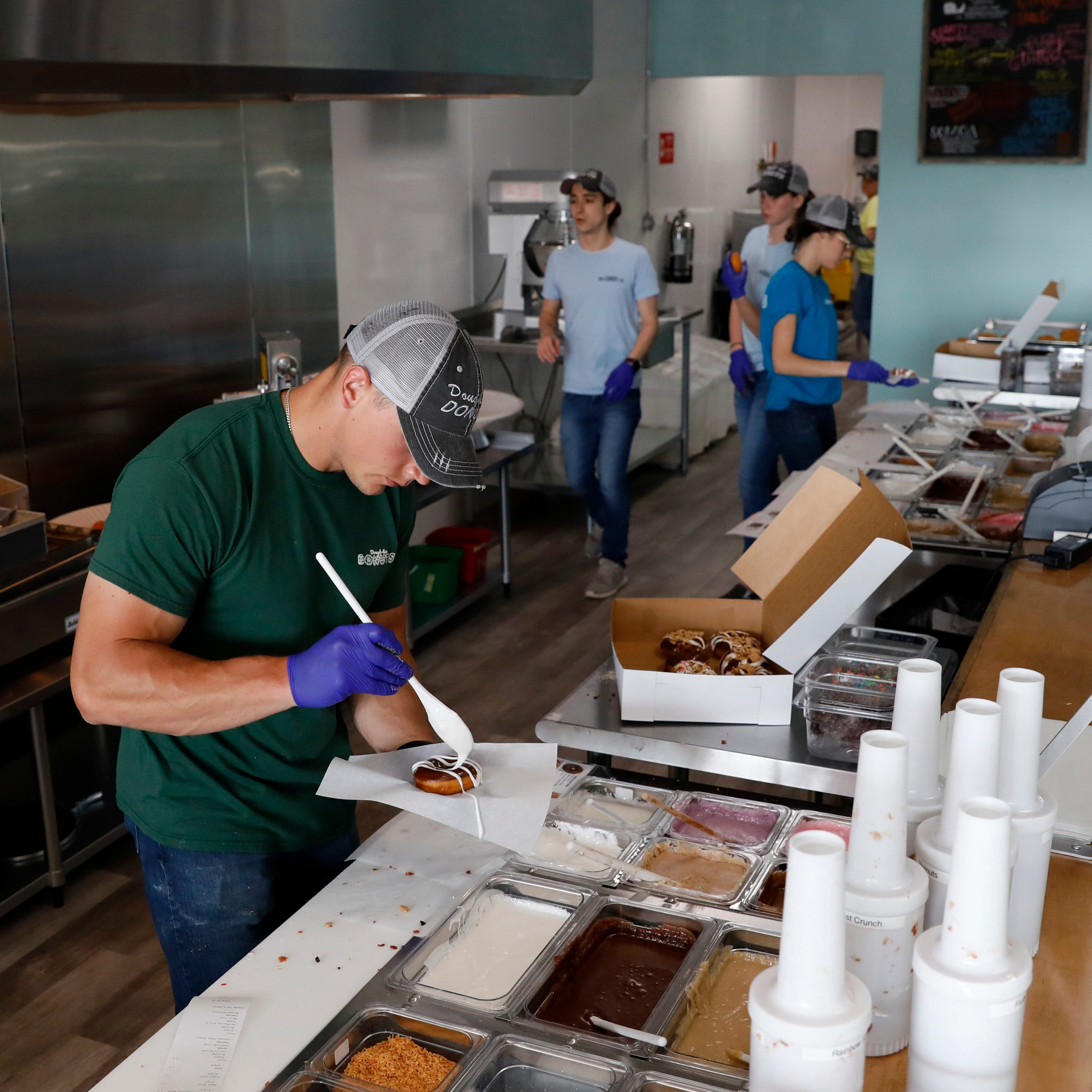 New doughnut shop on Memorial Drive lets customers watch workers make their treats