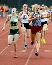 Howell's Ashlyn Tait (1) takes second by 0.02 seconds to Milford's Victoria Heilingenthal in the 800-meter run at the Division 1 track and field regional at Milford on Friday, May 17, 2019. Pinckney's Erika Rapp (8) and Brighton's Maddie Brown (3) also qualified for the state meet.