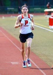 Pinckney's Noelle Adriaens won the 3,200-meter run at the Division 1 track and field regional at Milford on Friday, May 17, 2019.