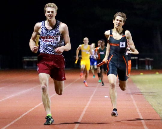 Gunnar Gustafson (left) edges Brighton's Brenden Edoff to give Milford first place in the 1,600-meter relay at the Division 1 track and field regional at Milford on Friday, May 17, 2019.