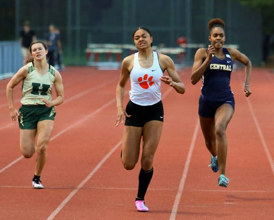 Brighton's Brooke Gray (center) won the 200-meter dash at the Division 1 track and field regional at Milford on Friday, May 17, 2019. Howell's Aliana Pietila (left) took fifth.