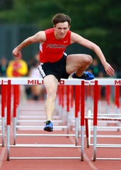 Pinckney's Dylan Deck qualified for the state meet in the 110-meter high hurdles at the Division 1 track and field regional at Milford on Friday, May 17, 2019.