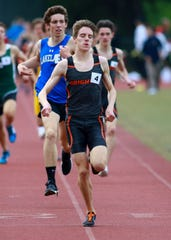 Brighton's Jack Spamer (4) won the 1,600 and 3,200 at the Division 1 track and field regional at Milford on Friday, May 17, 2019.