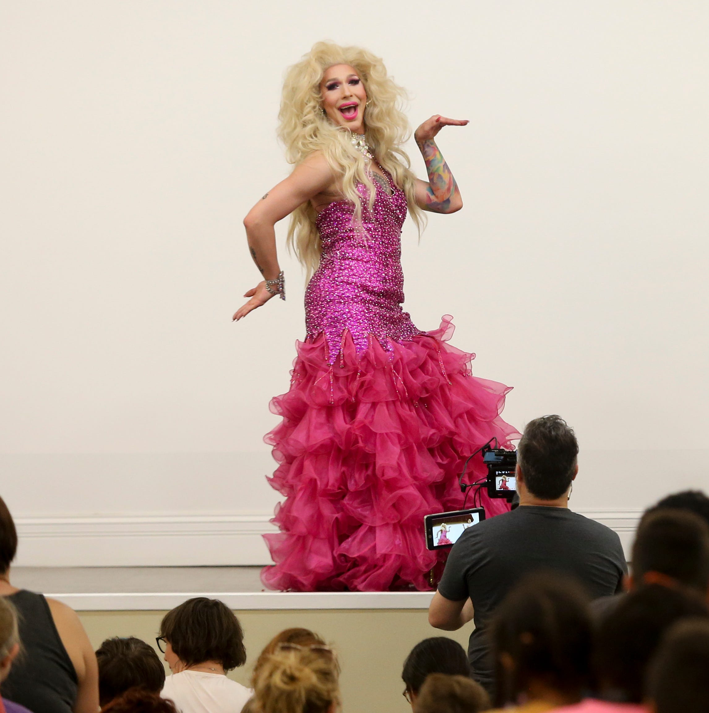 Drag Queen Storytime's Vanessa Demornay warms up the audience at the main Louisville Library on May 18.
