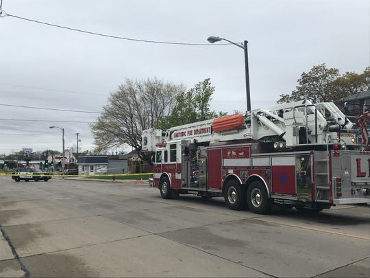 Emergency vehicles blocked off the area around the 1000 block of South 25th Avenue in Manitowoc as police investigate a possible explosive device.