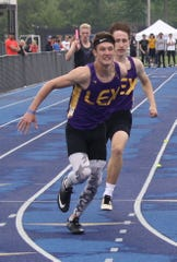 Lexington's Alex Green, taking the baton in the 4x200, set school records in winning the 100 and 200 dashes at the Division I district meet.