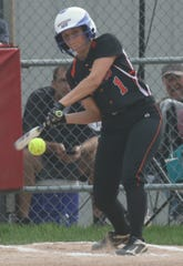 Lucas's Frankie Depue rips a hit during the Lady Cubs' district final loss to Monroeville on Friday night.