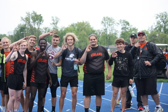 Their fingers tell the story as the Ashland Arrows celebrate a third straight Division I district track and field title.