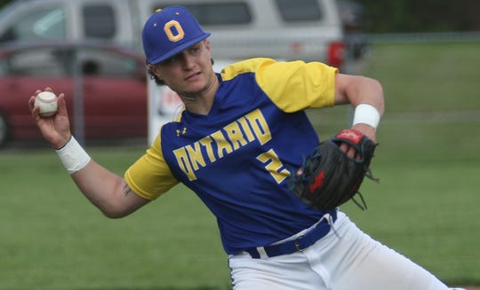 Ontario's Avery Fisher makes a play at shortstop during the Warriors' sectional championship loss to Shelby on Friday night.