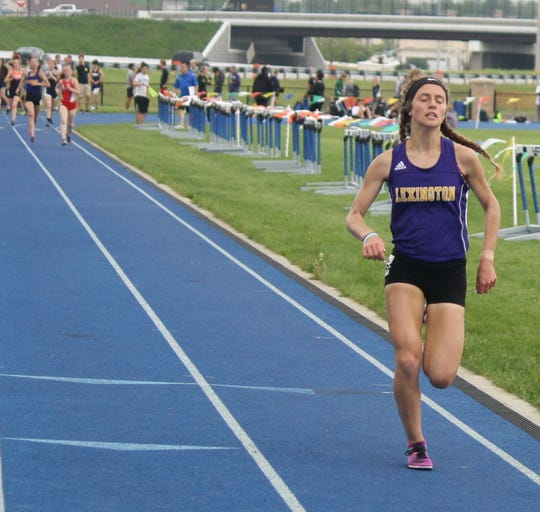 Lexington's Halle Hamilton ran an 11:14.50 breaking the previous Findlay High School stadium record of 11:26.95 during the Division I district meet over the weekend.