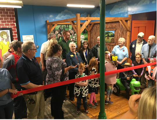 Jenny Roar, center, standing next to the wooden, brown barn post, is the new Malabar Farm State Park manager. She was onhand for the farm's ribbon cutting and new exhibit this past week at the Little Buckeye Children's Museum in Mansfield. Roar hails from Ashland County and assumed the job this past week.
