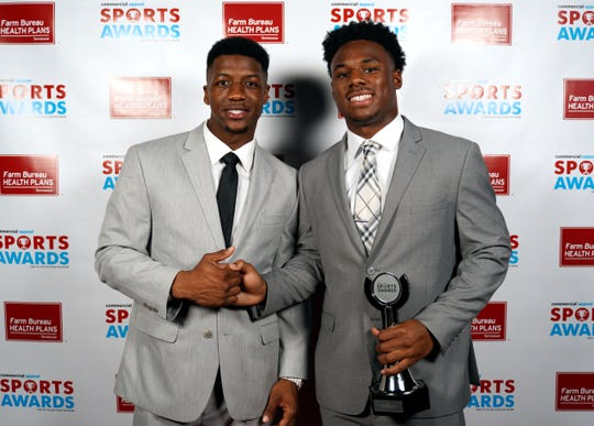 Maurice Hampton, right, poses with Anthony Miller at the 2019 Commercial Appeal Sports Awards.