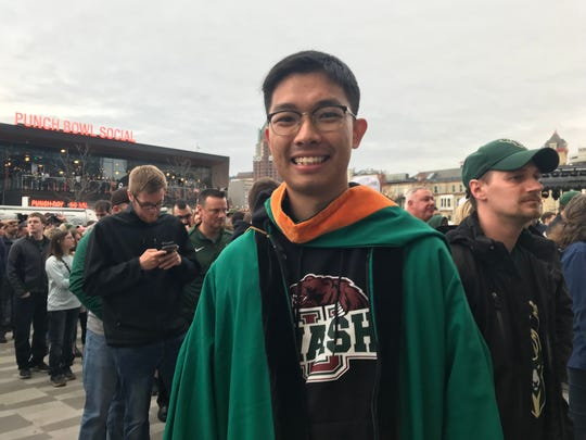 Chengke Ye of Foshan, China, wears his graduation gown in line to enter Fiserv Forum Friday. Ye graduated from Washington University in St. Louis Friday morning and drove to Milwaukee for Game 2 of the Eastern Conference finals.