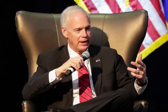 Sen. Ron Johnson speaks during an interview Saturday at the state GOP convention in Oshkosh.