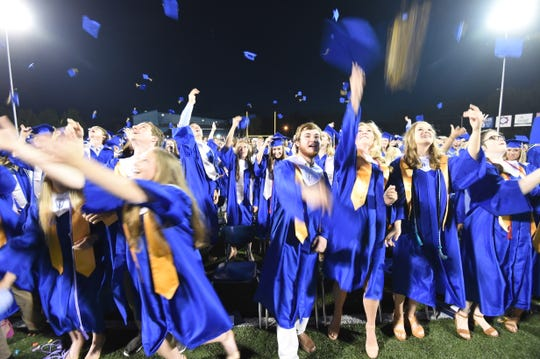 The 2019 graduating class of Mountain Home HIgh School toss their caps in the air Friday night after graduating. Go to www.baxterbulletin.com to see a photo gallery from the ceremony.