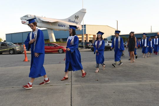 Traditional graduation ceremonies will be on hold until at least July 1, state officials said Saturday.