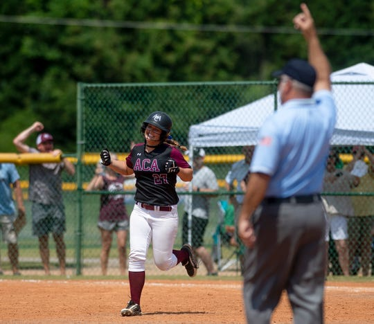 Alabama Christian's Hayley Cassidy cheers as she rounds the bases after hitting a walk off home run against Dale County during the AHSAA Softball Championships at Lagoon Park in Montgomery, Ala., on Saturday May 18, 2019.