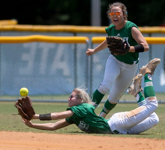 Brantley's Emory Bush dives for a ball as Brantley's Anna Kimbro looks on against Belgreen during the AHSAA Softball Championships at Lagoon Park in Montgomery, Ala., on Saturday May 18, 2019.