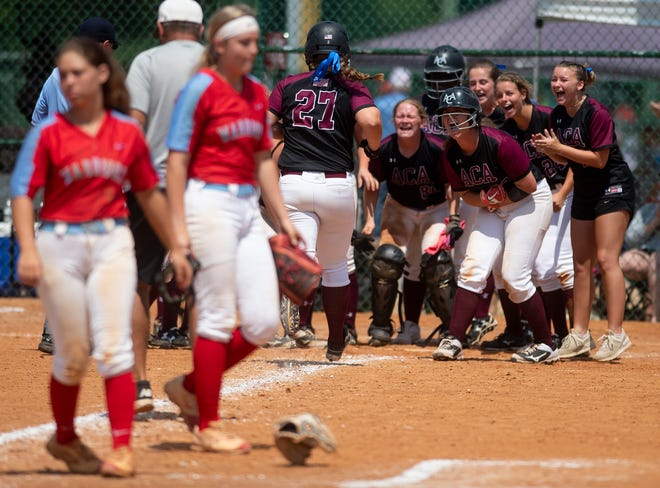 Alabama Christian's Hayley Cassidy is greeted at home after hitting a walk off home run against Dale County during the AHSAA Softball Championships at Lagoon Park in Montgomery, Ala., on Saturday May 18, 2019.