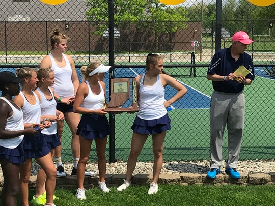 Delta receives the girls tennis sectional title trophy. The Eagles defeated the Muncie Central Bearcats, 5-0.