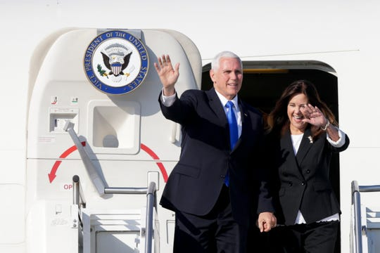 Vice President Mike Pence and Karen Pence emerge from Air Force Two, Saturday, May 18, 2019, at the Delaware County Airport in Muncie, Ind. Pence is in Indiana to deliver the commencement address at Taylor University in Upland, Ind.