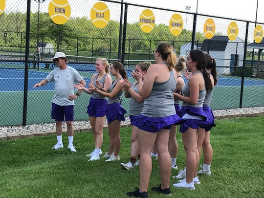 Muncie Central celebrates a well-competed match after a girls tennis sectional final loss against Delta. The Eagles defeated the Muncie Central Bearcats, 5-0.