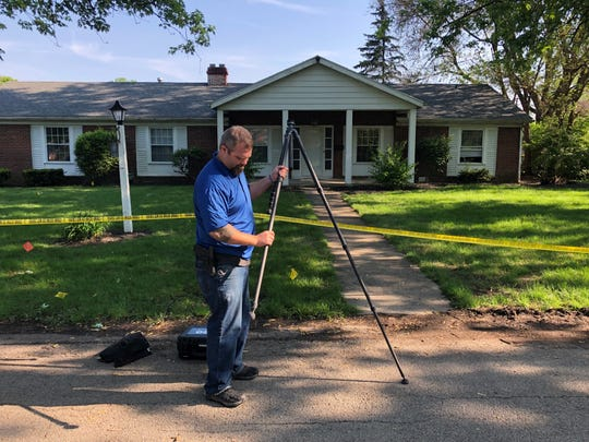Brian Jackson, MPD patrolman and crime scene investigator, sets up the Muncie Police Department's tripod-mounted FARO Laser Scanner outside the scene where seven people were shot during a party in the 2400 block of West Euclid Avenue on May 18, 2019.