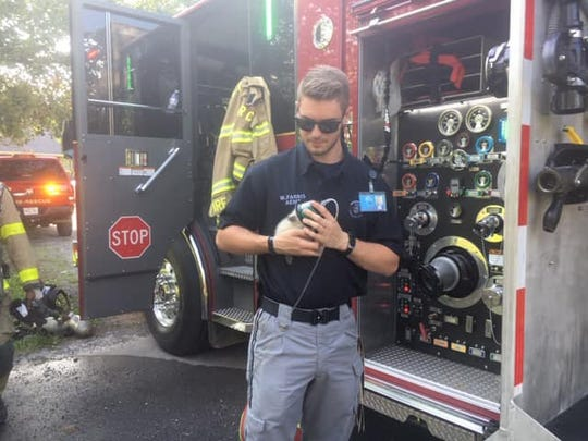 Rutherford County Firefighter Will Faris provides oxygen to revive a kitten rescued from a Leanna home on Friday.