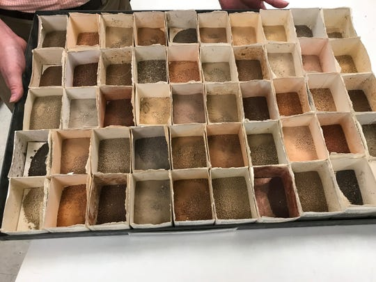 Dr. Robert Florence director of the UT Soil, plant and pest center, shows off a tray of soil that his lab is testing.