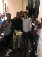 Lely's Kenneth Anyaehie celebrates signing as a preferred walk-on at Division I Temple with teammates (from left) Chevy Octa, Nick Obsaint and Jonis Dieudonne on Wednesday.