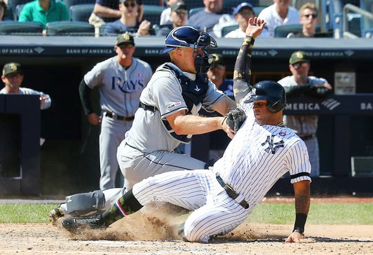 May 18, 2019; Bronx, NY, USA; New York Yankees center fielder Aaron Hicks (31) is tagged out at home plate by Tampa Bay rays catcher Erik Kratz (6) after attempting to score on a single by shortstop Gleyber Torres (not pictured) during the sixth inning at Yankee Stadium.
