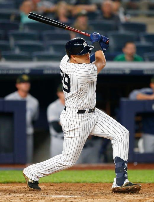 May 17, 2019; Bronx, NY, USA;  New York Yankees third baseman Gio Urshela (29) hits a walk off single in the ninth inning against the Tampa Bay Rays at Yankee Stadium.