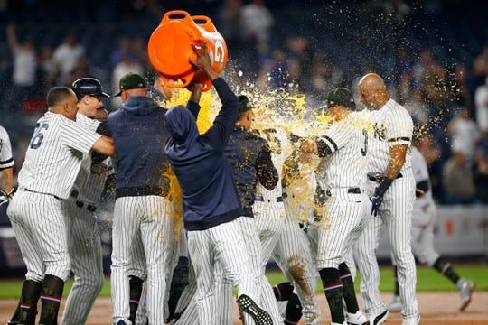 May 17, 2019; Bronx, NY, USA;  New York Yankees celebrate after third baseman Gio Urshela's  walk off single in the ninth inning against the Tampa Bay Rays at Yankee Stadium.