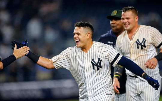 May 17, 2019; Bronx, NY, USA;  New York Yankees third baseman Gio Urshela (29) celebrates after hitting a walk off single in the ninth inning against the Tampa Bay Rays at Yankee Stadium.