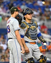 May 17, 2019; Miami, FL, USA; New York Mets starting pitcher Jacob deGrom (48) talks with catcher Wilson Ramos (40) near the pitching mound in the third inning against the Miami Marlins at Marlins Park.