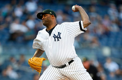 May 17, 2019; Bronx, NY, USA; New York Yankees starting pitcher CC Sabathia (52) pitches in the first inning against the Tampa Bay Rays at Yankee Stadium.