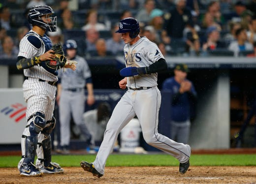 May 17, 2019; Bronx, NY, USA;  Tampa Bay Rays second baseman Daniel Robertson (28) scores a run in the eighth inning against the New York Yankees at Yankee Stadium.
