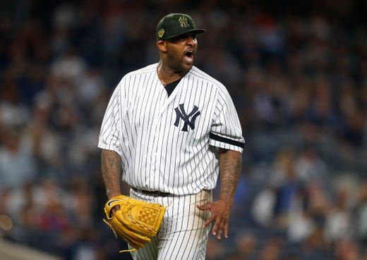 May 17, 2019; Bronx, NY, USA;  New York Yankees starting pitcher CC Sabathia (52) reacts on his way to the dugout in the sixth inning against the Tampa Bay Rays at Yankee Stadium.
