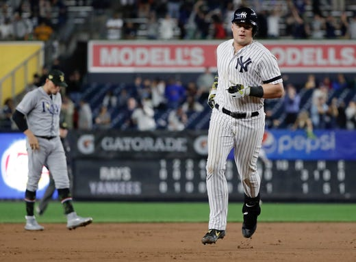 New York Yankees' Luke Voit runs the bases after hitting a home run during the ninth inning of the team's game against the Tampa Bay Rays on Friday, May 17, 2019, in New York. The Yankees won 4-3.