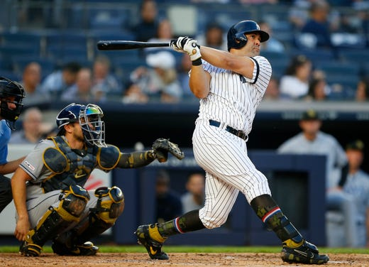 May 17, 2019; Bronx, NY, USA;  New York Yankees designated hitter Kendrys Morales (36) hits a home run in the second inning against the Tampa Bay Rays at Yankee Stadium.