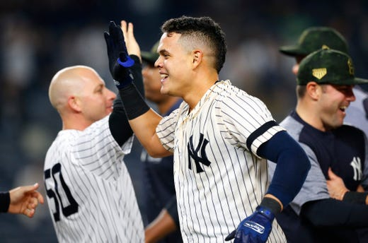 May 17, 2019; Bronx, NY, USA;  New York Yankees third baseman Gio Urshela (29) celebrates after hitting a walk off single in the ninth inning against the Tampa Bay Rays at Yankee Stadium.