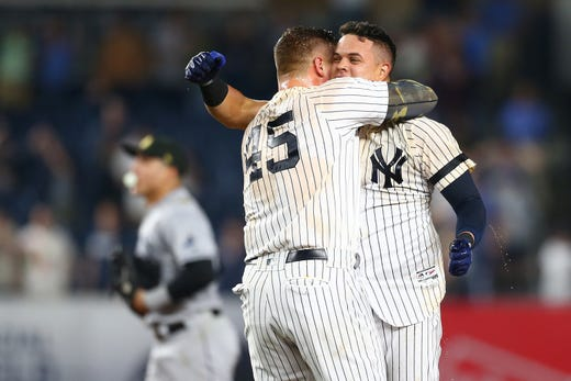 Gio Urshela #29 of the New York Yankees celebrates his walk-off game winning RBI single in the bottom of the ninth inning against the Tampa Bay Rays at Yankee Stadium on May 17, 2019 in New York City.