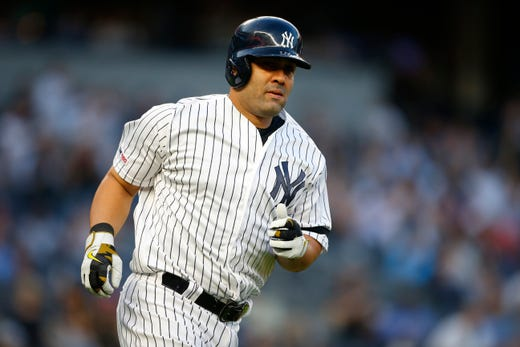 May 17, 2019; Bronx, NY, USA;  New York Yankees designated hitter Kendrys Morales (36) rounds the bases after hitting a home run in the second inning against the Tampa Bay Rays at Yankee Stadium.